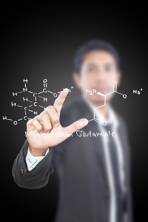 Teacher pushing scientific formula on the whiteboard  photo