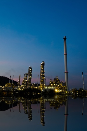 Reflection of petrochemical industry on sunset dark blue sky  Stock Photo - 13315545