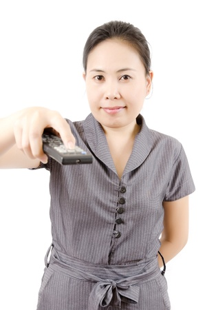 Asian woman using remote control isolated  photo