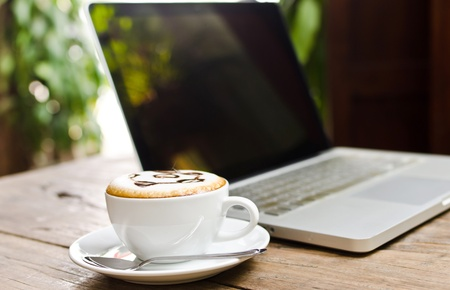 Coffee cup and laptop for business.