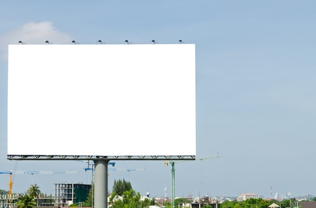 Blank Billboard on the blue sky in the City  photo