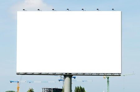Blank Billboard on the blue sky in the City
