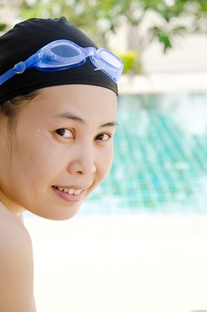 Close up woman swimming in swimming pool  photo