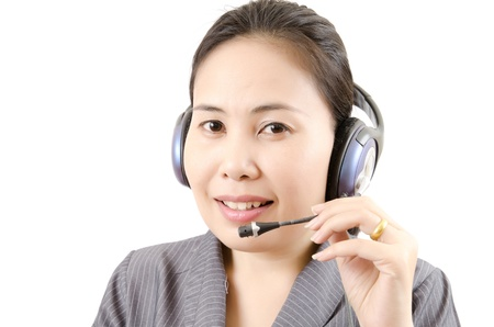 Business lady call centre employee speaking over the headset isolated Stock Photo - 14124130