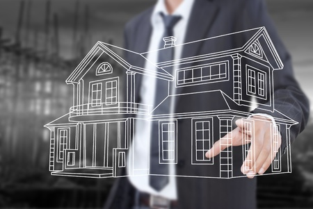Businessman pushing house plan for construction on the whiteboard Stock Photo - 14189071