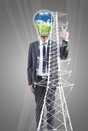 Businessman pushing High voltage power pole line  photo