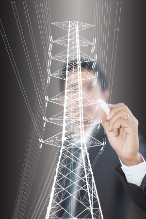 Businessman Drawing High voltage power pole line  photo