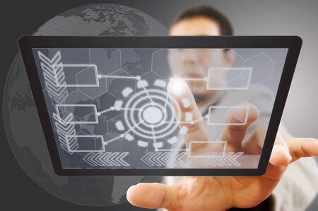 Businessman pushing digital button on tablet screen  photo