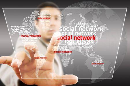 Businessman pushing Social Network world map  photo