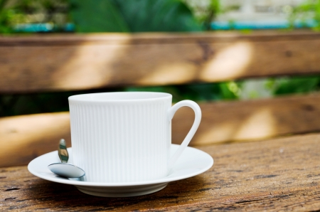 Coffee cup on the wood texture. photo