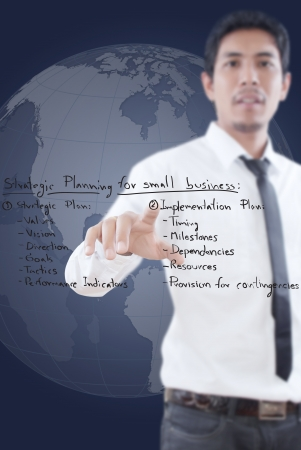 company vision: Businessman pushing business strategic planning on the whiteboard
