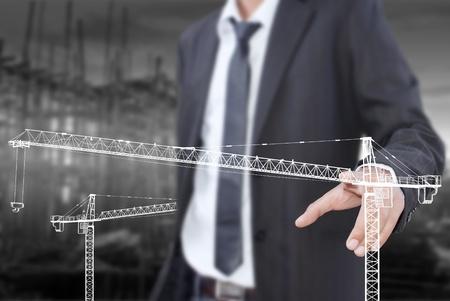 Businessman pushing Crane line for Construction concept  photo