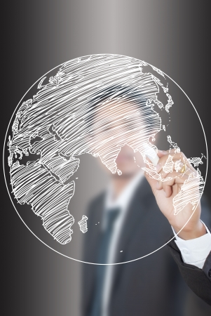 Businessman Drawing World Map Globe line on the whiteboard  photo