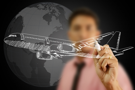 Businessman Drawing Airplane for travel around the world  photo
