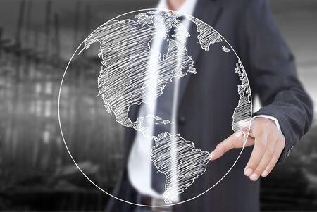Businessman pushing World Map Globe line on the whiteboard  photo