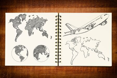 Airplane for travel around Earth Globe and World Map Detail sketch up on the notebook  photo