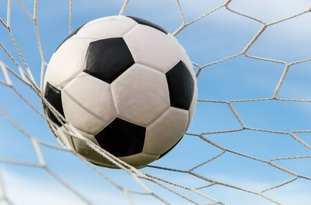 Soccer football in Goal net with sky field  Stock Photo - 15372148
