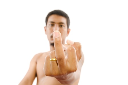 unkind: Hardcore Man is showing fuck off with the middle finger, Selective focus on Middle finger