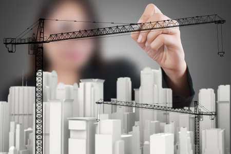 Business Lady drawing Crane line for Construction concept  photo
