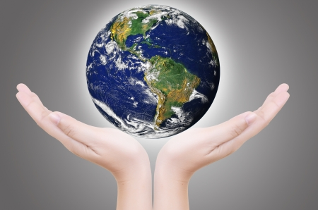 Hand Holding Glowing Earth Globe photo
