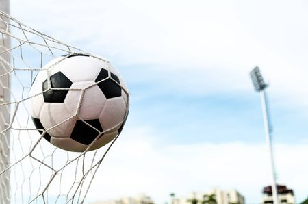 Soccer football in Goal net with sky field Stock Photo - 16215102