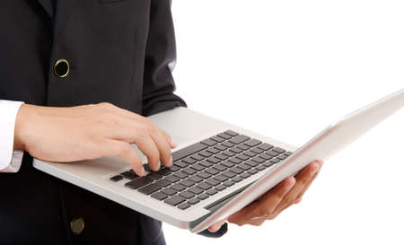 Businessman pushing on laptop keyboard for Business Concept  photo