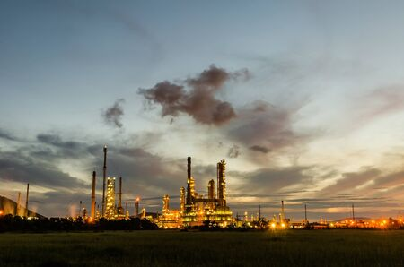Oil refinery plant at twilight dark blue sky  photo