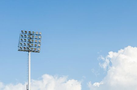Big sport light in Soccer Stadium with Blue Sky  photo