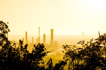 Oil refinery plant at twilight dark blue sky with the mist  photo