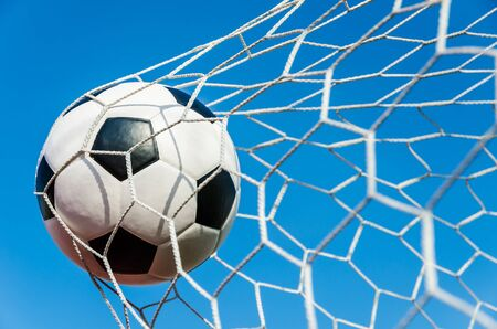 Soccer football in Goal net with Blue sky field. Stock Photo - 18655407