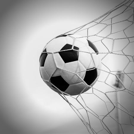 Soccer football in Goal net with Blue sky field  photo