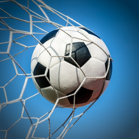 Soccer football in Goal net with Blue sky field  Stock Photo - 18976149