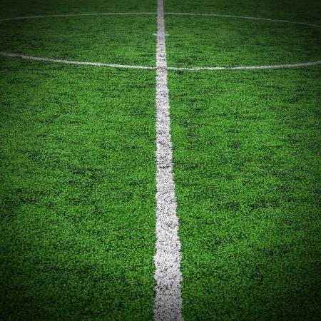 pasto sintetico: Parte central de una cancha de f?tbol soccer
