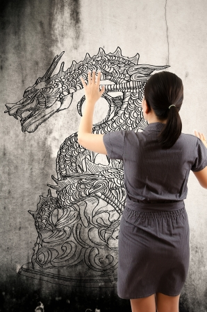 Business Lady Touching Chinese Style dragon statue line  photo