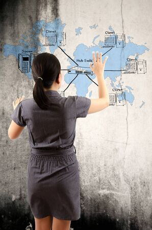 Business Lady touching Detail of Business and Technology Concept on the wall  photo