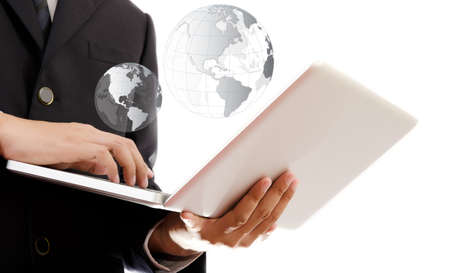 Businessman pushing on laptop keyboard for Business Concept with World Map Globe   photo