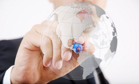 Businessman Drawing World Map Globe for Business and Technology Concept