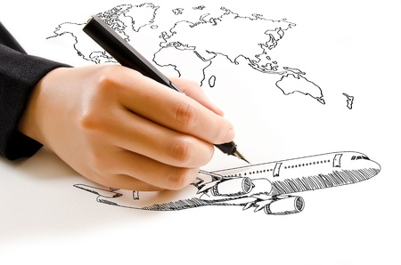 Hand Drawing Airplane for travel around the world  photo