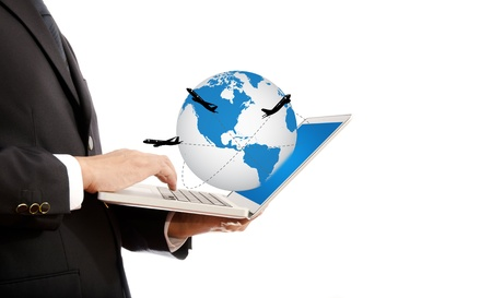 Businessman pushing on laptop keyboard for Business Concept with World Map Globe  with airplane around the globe  photo