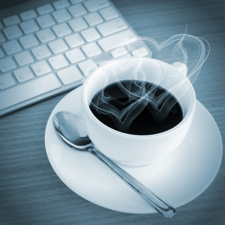 Coffee Cup on the Table with Computer Keyboard for Business Concept  photo