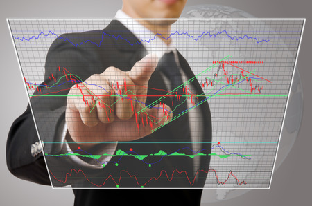 Businessman pushing finance graph for trade stock market on the Touchscreen Interface. photo