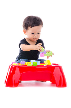 1: Cute Little Boy Playing Toy Isolated on the White Background.
