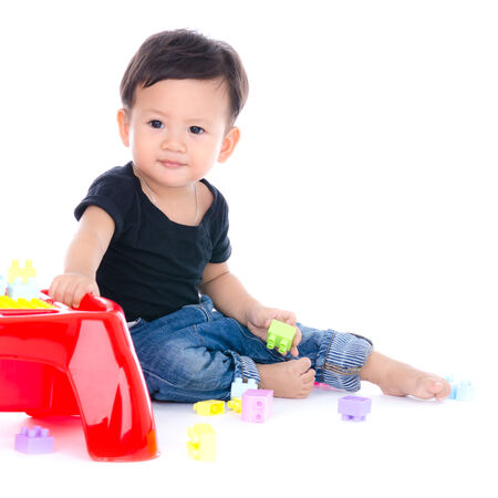 Cute Little Boy Playing Toy Isolated on the White Background. photo