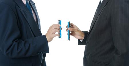 ringtones: Businessman putting mobile phone.
