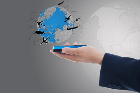 ringtones: Business hand Holding mobile phone with world map globe, Transport and Technology Concept.