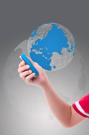 ringtones: mobile phone with world map globe Stock Photo