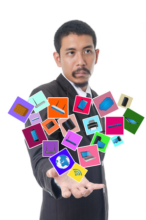 Businessman Holding Computer Icons, For Business and Technology Concept, Isolated on the white background. photo