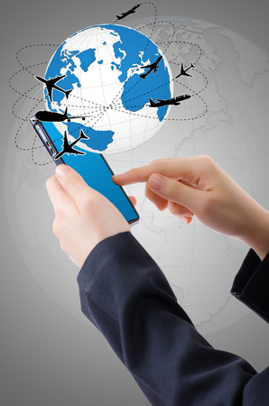 ringtones: Hand Holding mobile phone with world map globe, Transport and Technology Concept.