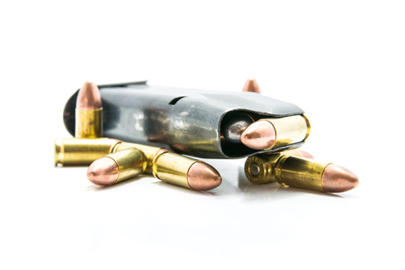 Gun and Bullets isolated on the white Background. Stock Photo