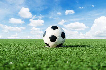 Soccer Football on the green grass of Soccer field.